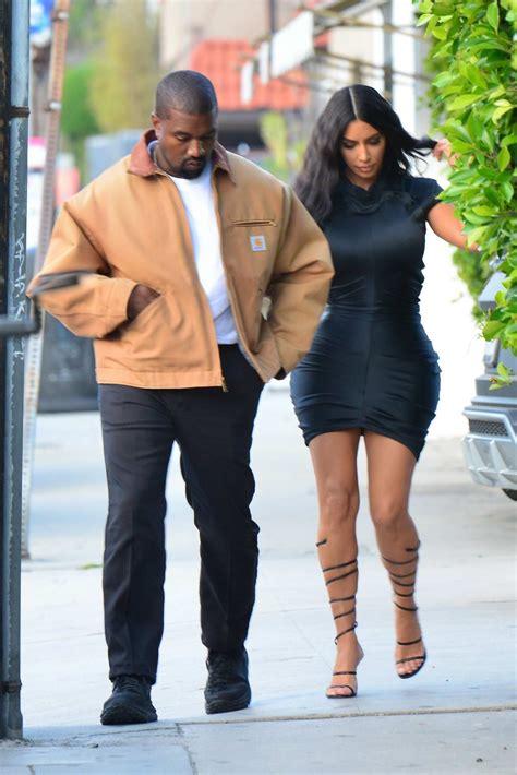 kim kardashian rocks form-fitting short black dress while ...