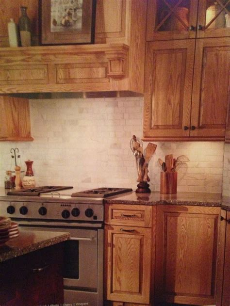 picture of kitchen backsplash oak cabinets with carerra back splash kitchen
