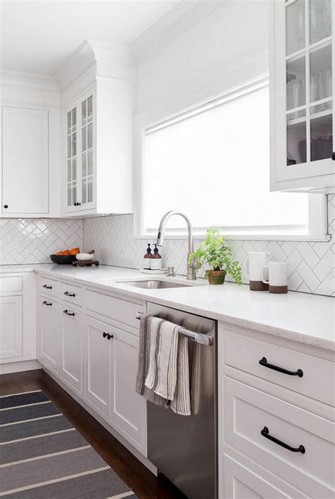 benjamin moore decorators white cabinets new amp fresh interior design ideas for your home home 306 | Shaker Kitchen Cabinets with simple herringbone subway tile and white marble countertop. Shaker style cabinets are painted in Benjamin Moore Decorators White