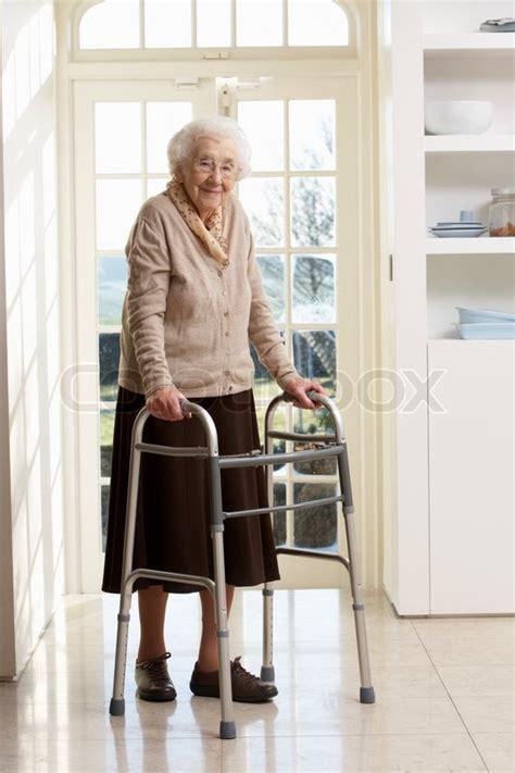 elderly senior woman  walking frame stock photo