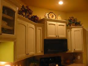 top of kitchen cabinet decor ideas decorating ideas for the top of kitchen cabinets pictures afreakatheart