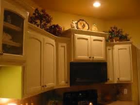 top kitchen cabinet decorating ideas decorating ideas for the top of kitchen cabinets pictures afreakatheart