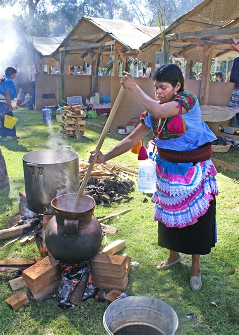 clay pot cooking corn drink prepared   olla de