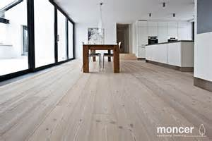 interior natural kahrs flooring design with wooden dining
