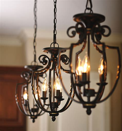 three wrought iron hanging pendant light fixtures