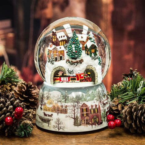 large snow globes christmas large snowy snow globe moving musical santa claus the book of