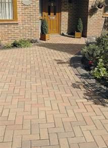 modern block paved driveway featuring brett omega multi