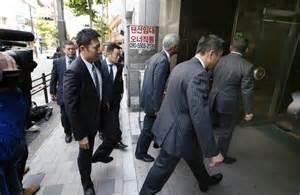 tokyo police arrest   yakuza linked health insurance