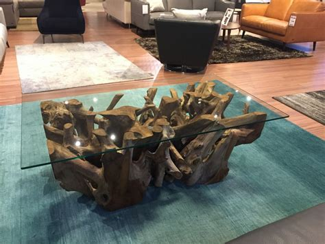 Differences in form, color are naturally occurring in the wood. Anya Teak Root Rectangular Coffee Table-3966832-000-000-CG