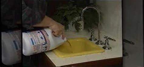 unclog  backed  kitchen sink plumbing