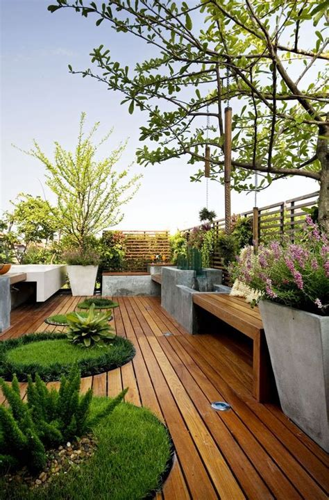 picture of wooden deck with potted plants and lawn oasises