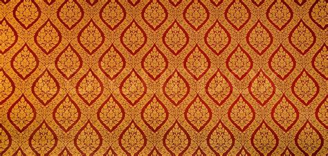 the traditional thai style art golden painting pattern on the wall in temple this is