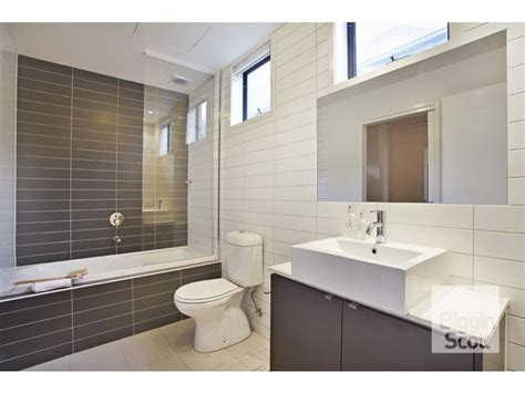 modern bathroom design with corner bath using ceramic bathroom photo 1490431