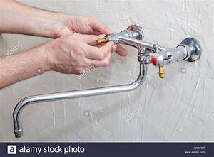 Plumber Fixing Water Tap With Leaking Water  Double Handle
