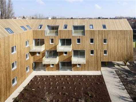 modern green social housing complex rises east of
