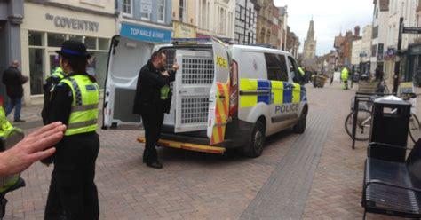 heavy police presence  gloucester city centre  woman