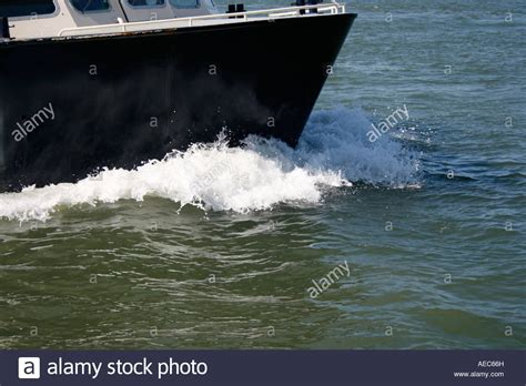 The Bow Of A Boat Where by On The Crest Of A Wave The Bow Of A Boat Cutting Through