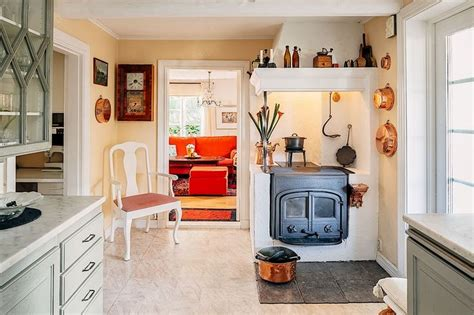 A sleek scandinavian morso wood stove replaced the previous unit, which had been situated so that its stovepipe blocked views from the kitchen and dining room. 201 best Classic and modern Scandinavian wood stoves. images on Pinterest | Wood burning stoves ...