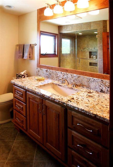 granite bathroom countertops  dark wood cabinets