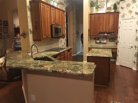 neptune bordeaux granite countertops in kitchen