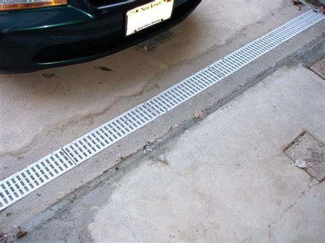 garage drainage solutions driveway grates arid basement waterproofing