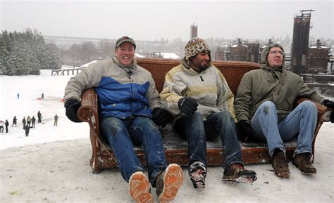 Three guys couch surfing, coats, boots, levis, snow day, p ...