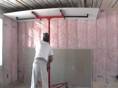 ceiling drywall install with lift by laurier desormeaux