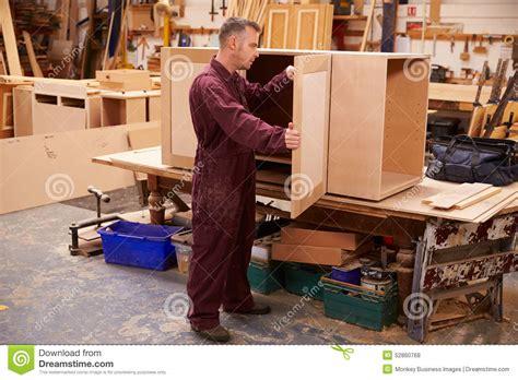 carpenter making furniture royalty  stock photo