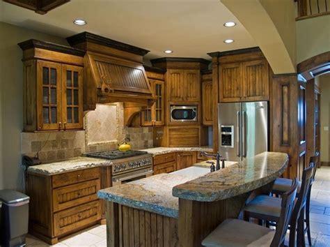 Custom knotty alder wood cabinets and hood. Travertine