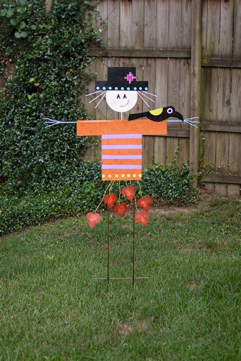 painted metal scarecrow yard art