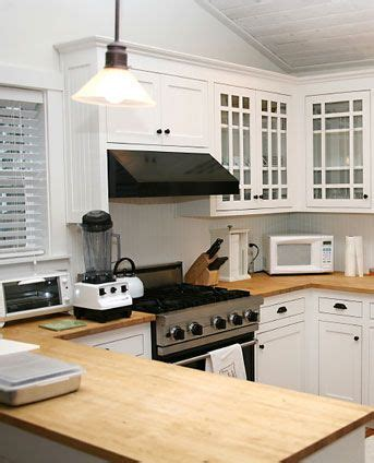 white kitchen cabinets with wood countertops 29 best images about kitchen ideas on 2092