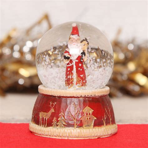 traditional christmas snowglobes traditional santa mini snow globe dome by berry apple notonthehighstreet