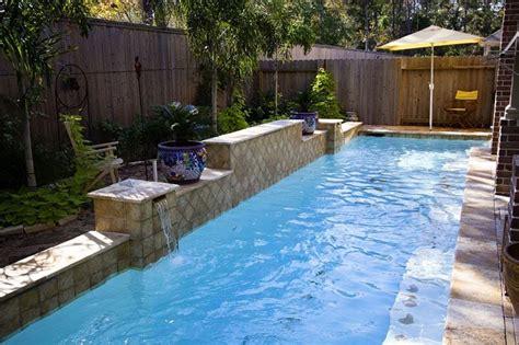 narrow lap pool  swim jets  raised wall