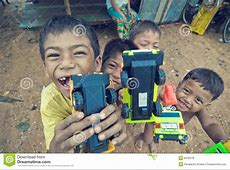 Poor cambodian kid playing editorial stock photo Image of