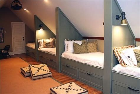 beautiful attic bunkroom features builtin storage bed tucked below