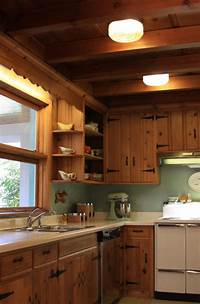 knotty pine cabinets A knotty pine kitchen - respectfully retained and revived ...