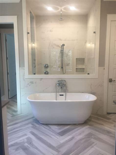 master bathroom   standing soaker tub herringbone