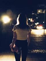 Girl walking at night