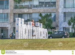 Woman Posing For Photo In Montevideo Letters Editorial ...