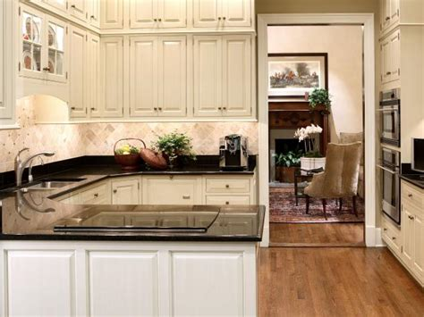 small kitchen  peninsula  tumbled tile backsplash