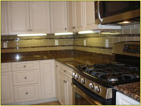 baltic brown granite countertops with white cabinets