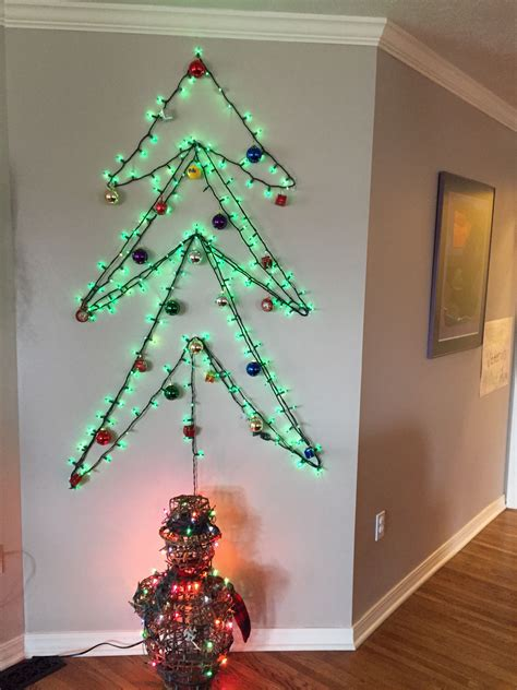 Here are some gorgeous designs for 2021 that will enhance your living space. Lighted wall Christmas tree   Wall christmas tree, Christmas tree, Holiday decor