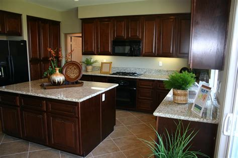 brown cabinets with white countertops white marble countertops on varnished mahogany kitchen