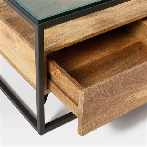 Make a feature of your coffee table by letting it take centre stage in your living room. Box Frame Storage Coffee Table | west elm UK
