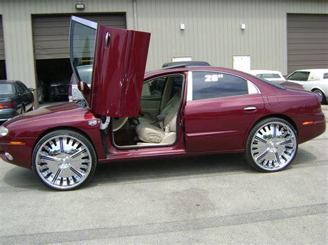 oldsmobile aurora 2001 models - Auto-Database.com