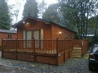 lake windermere log cabins with tubs log cabin on shores of lake windermere surrounded by