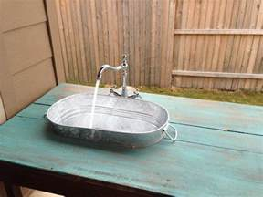 outdoor kitchen sink faucet turn a wooden cable spool into an outdoor kitchen or garden sink diy projects for everyone
