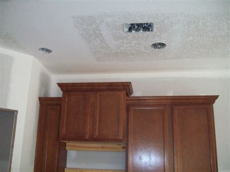 Staggered Kitchen Cabinets With Crown Molding Trim The
