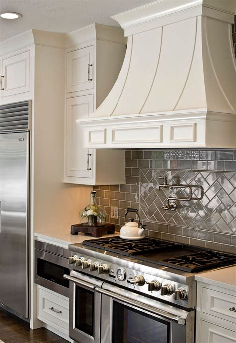 white cabinets gray subway tile pot filler thermadore