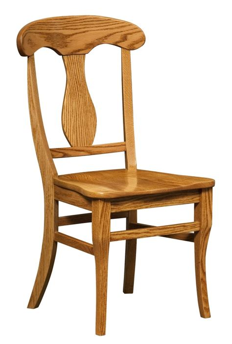 light brown wooden chair with high back and curving ornament on the middle completed with four